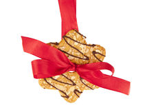 Biscuit hanging on celebratory ribbon Royalty Free Stock Images