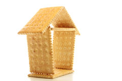 Biscuit house. Small house made by biscuit on the white background Royalty Free Stock Photos