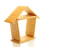 Biscuit house. Small house made by biscuit on the white background Stock Image