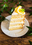 Biscuit layered cake with cream cheese and lemon curd decorated with fresh mint leaves, physalis, lemon slices and green grapes Stock Photo
