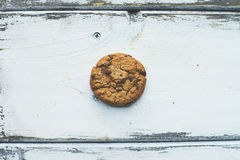Biscuit. One biscuit on white wooden background Stock Photos