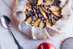 Biscuit with peach and blueberry. A piece of biscuit with peach and blueberry, top view Stock Image