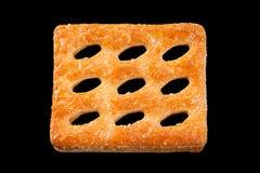Biscuit perforé carré Photographie stock libre de droits