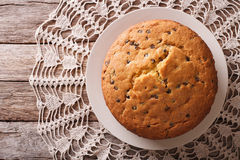 Biscuit pie with chocolate Drops on a plate. horizontal top view Royalty Free Stock Images