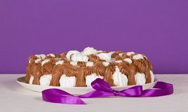 Biscuit pie on white cloth and ribbon Stock Photos