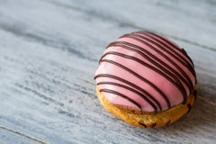 Biscuit with pink icing. Royalty Free Stock Images
