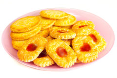Biscuit on a pink plate Stock Images
