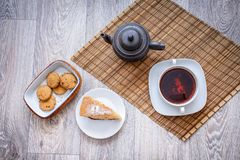 Biscuit plum cake on a plate with a cup of tea of hot space on a stock image