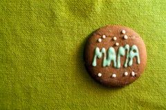 Biscuit pour le jour de mère sur le fond vert Photographie stock libre de droits