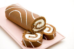 Biscuit role with filling. Biscuit role with chocolate and filling Royalty Free Stock Image