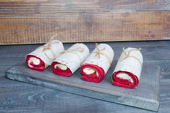 A biscuit roll wraped in a lace napkin Royalty Free Stock Photo
