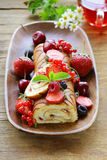 Biscuit roulade with butter cream and berries Stock Images
