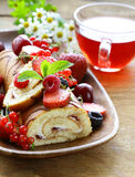 Biscuit roulade with butter cream and berries Royalty Free Stock Photo