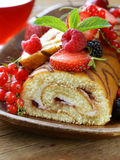 Biscuit roulade with butter cream and berries Stock Photography