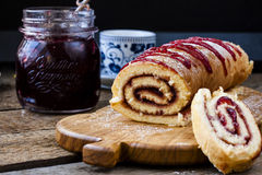 Biscuit roulade with cherry jam Stock Photography