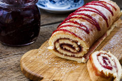 Biscuit roulade with cherry jam Stock Images