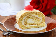 Biscuit roulade with cream. And white chocolate Royalty Free Stock Photo