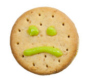 Biscuit with sad face Stock Photos