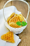 Biscuit in the shape of hearts in a white basket with mint Stock Images