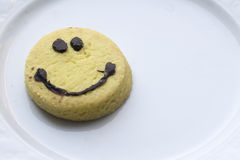 Biscuit souriant de visage Images libres de droits