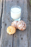 Biscuit, spice cakes and milk Stock Images