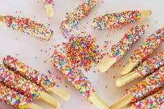 Biscuit stick coated with rainbow Royalty Free Stock Image