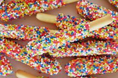 Biscuit stick coated with rainbow Royalty Free Stock Photo