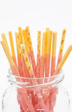 Biscuit stick strawburry coated. Japanese snack food biscuit stick strawburry coated in glass bottle Stock Images