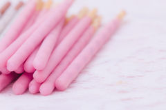 Biscuit sticks covered in  strawberry chocolate flavored and coo Royalty Free Stock Photography