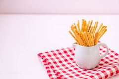 Biscuit sticks on wood. Background Royalty Free Stock Image