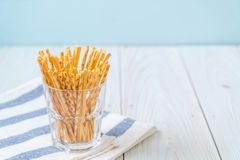 Biscuit sticks on wood. Background Royalty Free Stock Images