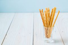 Biscuit sticks on wood. Background Stock Images