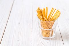 Biscuit sticks on wood. Background Royalty Free Stock Photo
