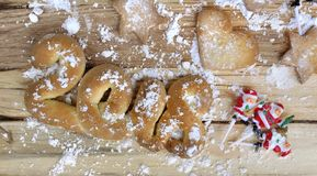 2018 in biscuit on table. 2018 in biscuit in sugar on wooden Stock Photos