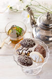 Biscuit and tea. Variety of biscuit over bowl and tea royalty free stock images
