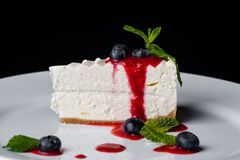 Biscuit White Cake with Mint and Blueberry with Strawberry Jam stock image