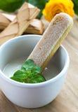 Biscuit in white yogurt in ceramic bowl. Stock Images