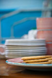 Biscuits. Biscuit and on a plate with crockery in the background Royalty Free Stock Images