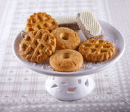 Biscuits. Some different kind of biscuits over a white upstand royalty free stock images