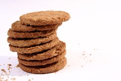 Biscuits. A stack of biscuits and crumbs on a white background Royalty Free Stock Photo