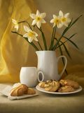 Biscuits. Still-life with biscuits and narcissus Royalty Free Stock Photo