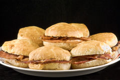 Biscuits. Bacon biscuits captured on a plate with a black background stock photos