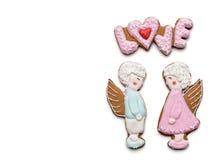 Biscuits avec le texte de l'amour et des anges Image libre de droits