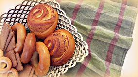Biscuits, bagels, rolls in a basket on the table. Royalty Free Stock Photography