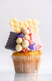 Biscuits and bonbons cupcake Stock Photo