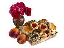Biscuits in a box, nectarines and roses. Biscuits in a box, nectarines and a bouquet of roses Stock Photo