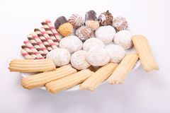 Biscuits, cakes and petits fours. Cakes, biscuits, candies and petits fours presented in a dish Royalty Free Stock Image