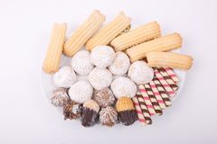 Biscuits, cakes and petits fours. Cakes, biscuits, candies and petits fours presented in a dish Stock Photo