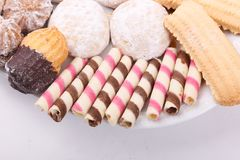Biscuits, cakes and petits fours close up. Cakes, biscuits, candies and petits fours presented in a dish Stock Images