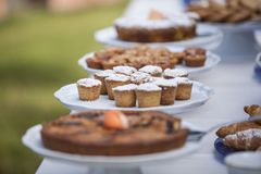 Biscuits and cakes on a table stock images